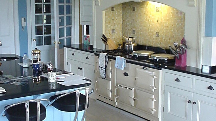 blue kitchen with Aga and white cabinets - robinson and cornish via Atticmag