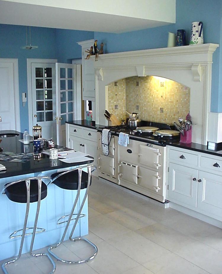 blue kitchen with Aga and white cabinets - robinson and cornish via Atticmag