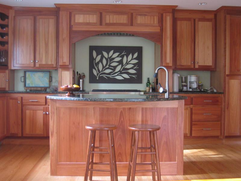 The beauty of sustainable, natural wood is well expressed in lyptus cabinets .