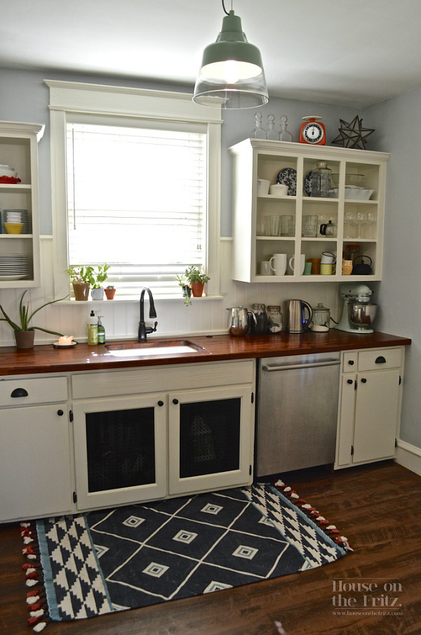 kitchen rugs - black, white and red geometric flat weave rug in a gray and white kitchen - House on the Fritz via Atticmag
