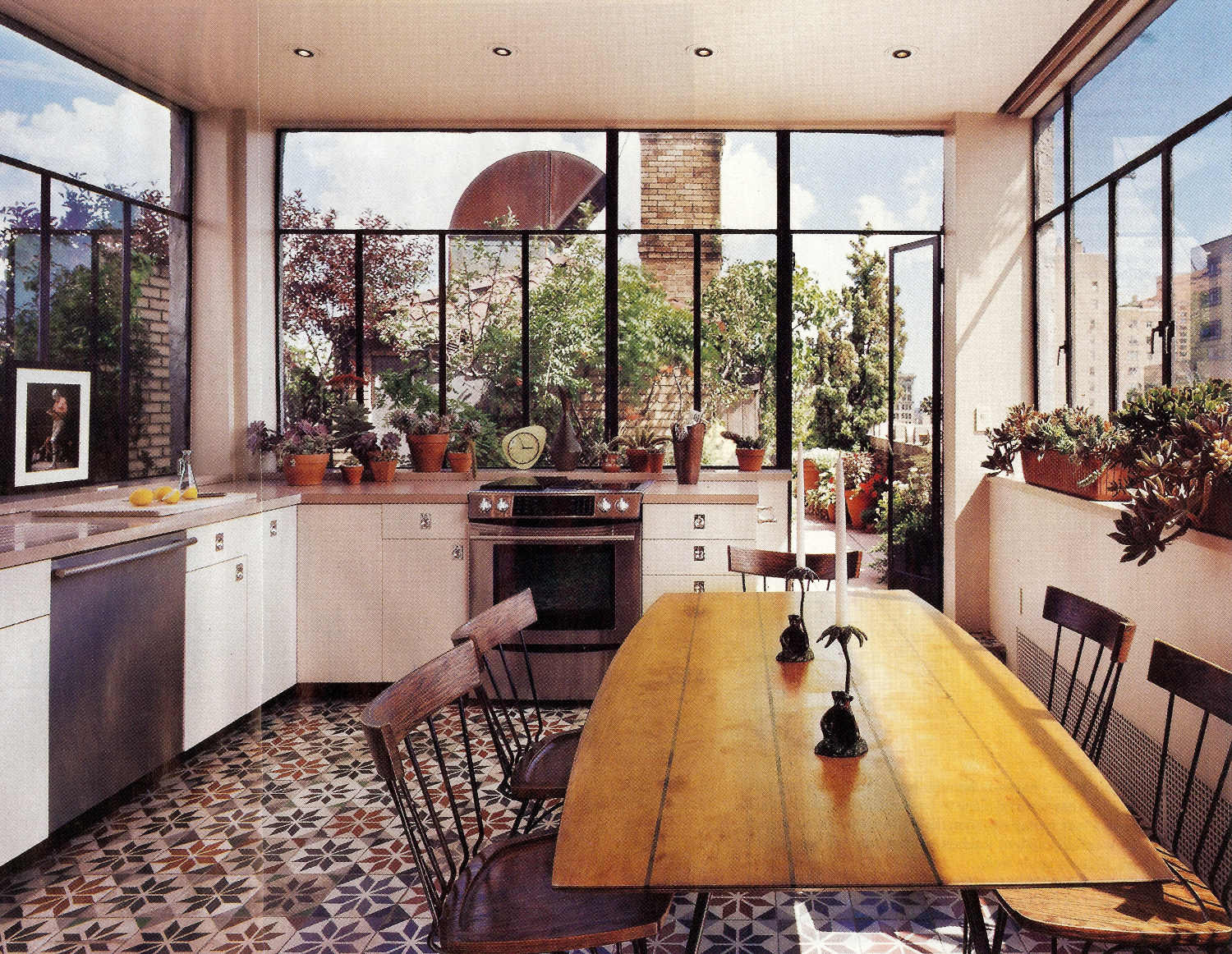 Penthouse kitchen a patterned moroccan tile floor adds spice to a stunning city penthouse kitchen dailygadgetfo Gallery