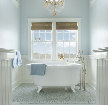blue cottage bath - glass tile mosaic, a free standing tub and light blue walls painted in Farrow & Ball's Borrowed Light create a heavenly cottage bathroom - Frank Roop via Atticmag