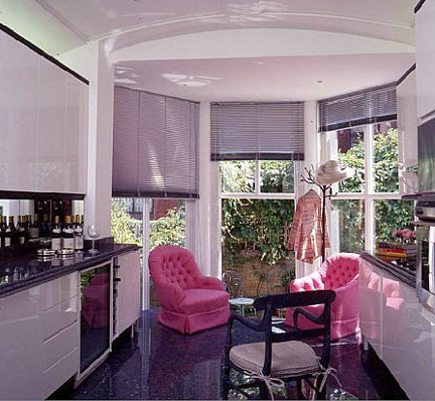 kitchen with solarium and seating by Geoffrey Bradford
