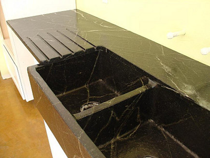 kitchen feature ideas - custom soapstone farm sink with runnels or integral drainboard grooves - gardenweb via atticmag