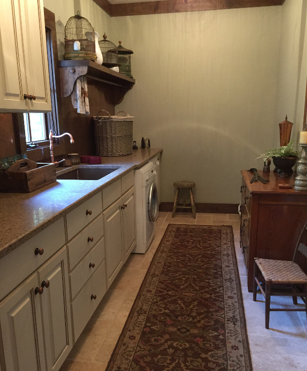 alabama stone cottage - laundry room with stone flooring Tulsa architect Jack Arnold - Atticmag