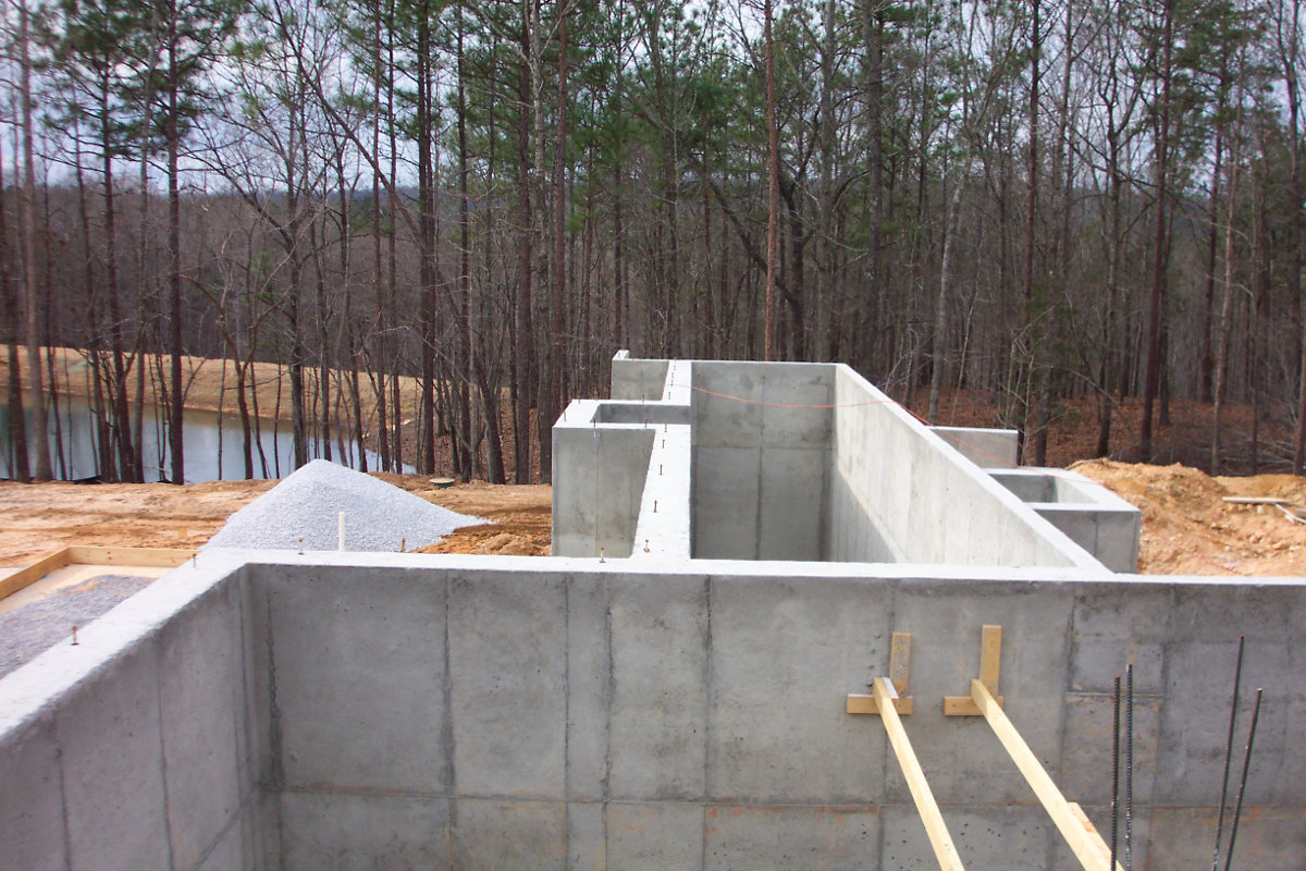 alabama stone cottage - foundation during construction - atticmag