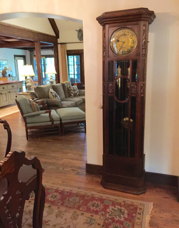 alabama stone cottage - grandfather clock in dining room - atticmag