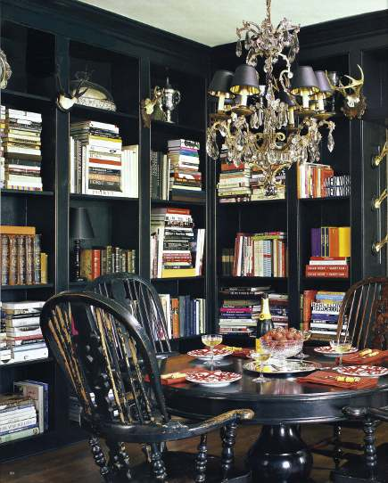 black dining room with bookcases