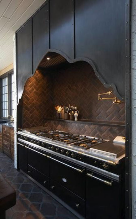 historic home kitchen - black European model LaCanche Sully 2200 range with custom iron hood - 11 Bonita via Atticmag
