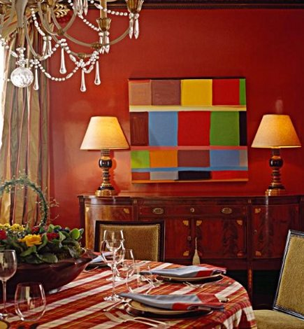 color block painting on a dark red dining room wall