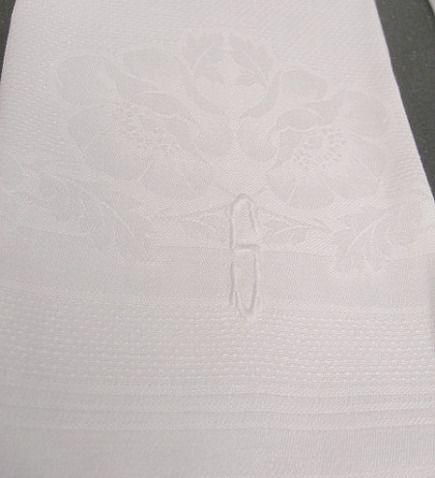 white damask hand towel with peony design and monogram