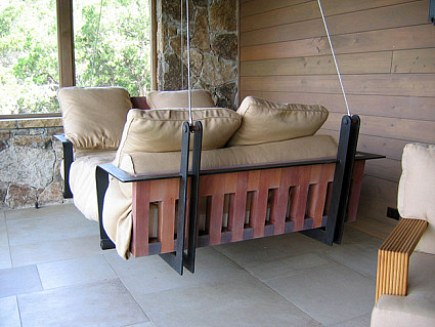 custom hanging swinging porch bed made from wood and metal