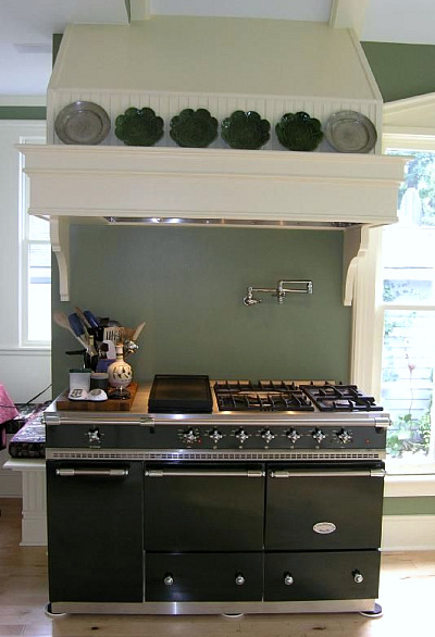 green Lacanche cluny range in black and white kitchen in a Victorian cottage kitchen - gardenweb via atticmag