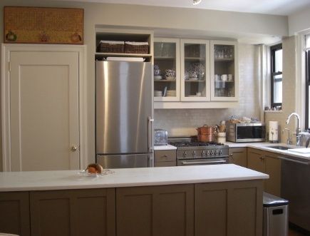 kitchen upgrades - new appliances and wall color in a taupe-gray renovated apartment kitchen - Atticmag