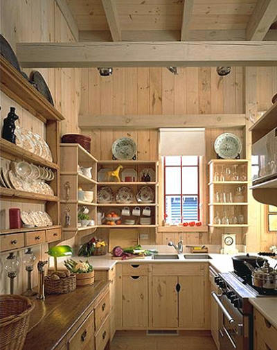 simple rustic whitewashed pine kitchen with open cabinets