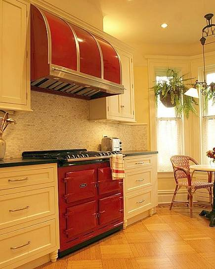 off-white white kitchen with red Aga range and hood