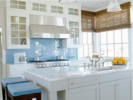 white kitchen trend - White kitchen with robin's egg blue backsplash by Suzanne Kasler via Atticmag
