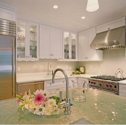 white kitchen trend - white kitchen with glass counters - via Atticmag