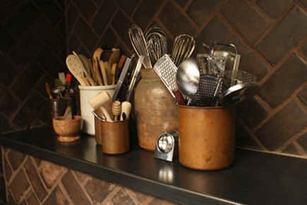 historic home kitchen - copper pots holding kitchen utensils on the shelf behind the Lacanche range - 11 Bonita via Atticmag
