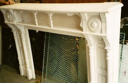 fireplace renovation - the salvage Victorian mantel painted white in the  basement at Old Goode Things - Cinderalla Fireplace