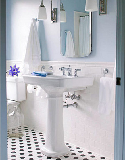 bathroom with white tile painted with Sherwin Williams Hinting Blue