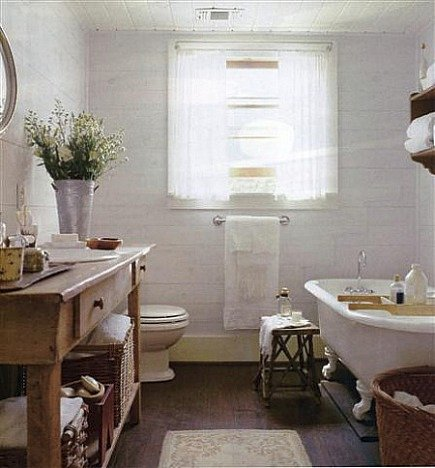 unfitted farmhouse style bathroom with claw footed tub and open sink cabinet