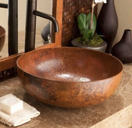 Native Trails copper vessel sink on marble counter with oil-rubbed bronze faucet