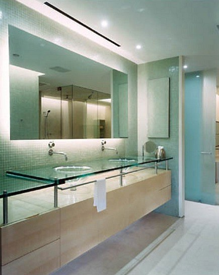 A Minimalist Spa Bath Has A Unique Floating Vanity With A Transparent Sink  And Counter.