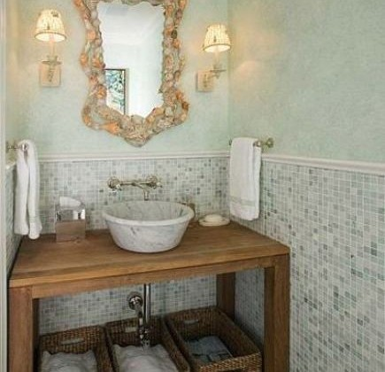 tiled wall powder room with vessel sink of open table, mirror and sconces