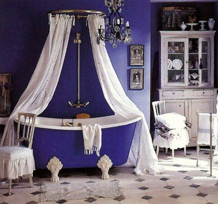 purple bathrooms - blue-violet bathroom with cottage style clawfoot tub and walls - via Atticmag