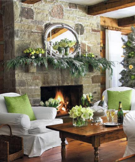 stone fireplace christmas mantel decorated with pine