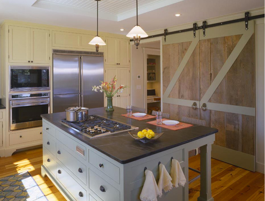 interior barn doors - in a kitchen - hutker architects via atticmag
