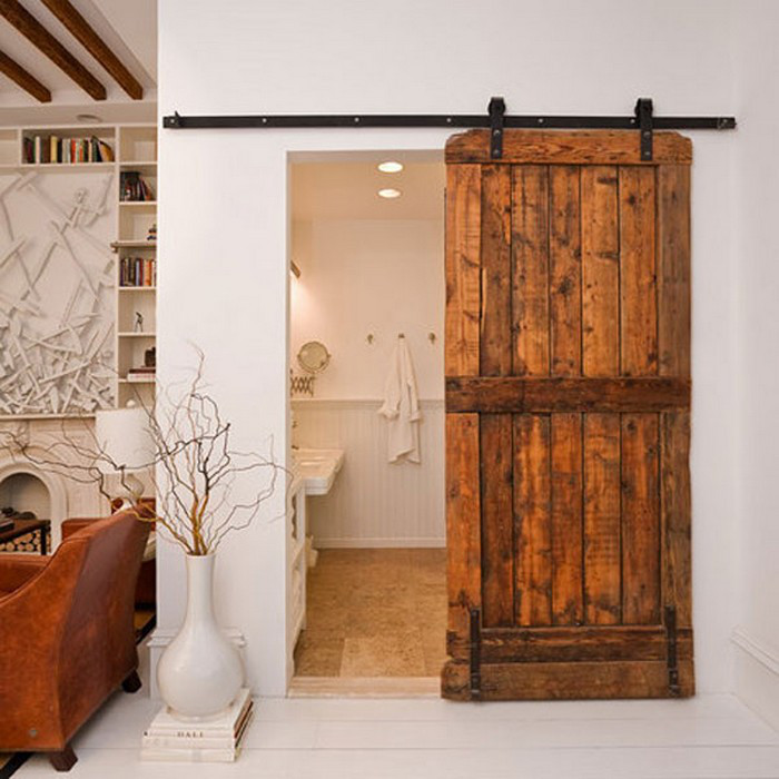 interior barn doors - powder room with rustic barn door - southern living via atticmag
