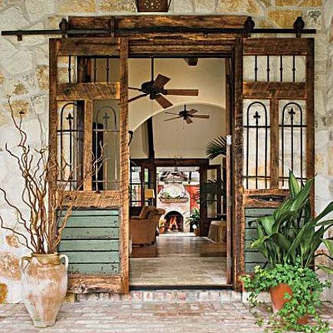 interior barn doors - salvage barn doors created from several pieces - southern living via atticmag