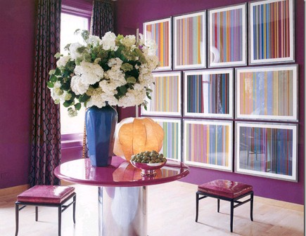 suite of prints on a purple wall by Jamie Drake