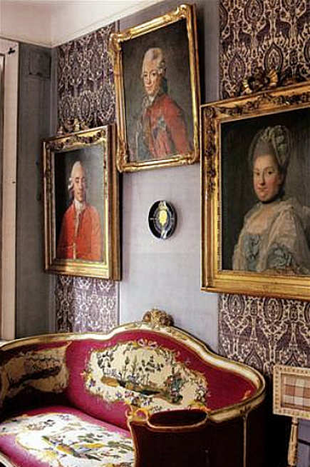 Swedish picture wall with fabric and antique portraits