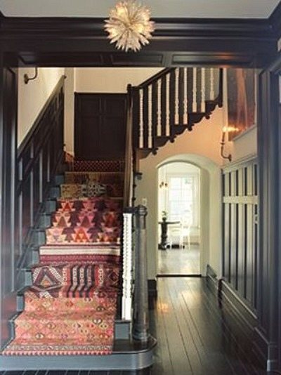 kilim rugs - Patchwork Kilim stair runner stands out against dark woodwork - via Atticmag