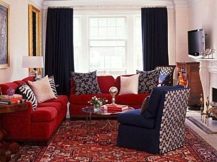 Living room with Heriz rug, red sofa and blue chairs by designer Amanda Nisbet