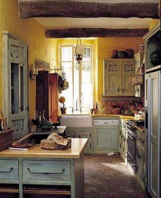 The Blue Rooster Motif Cut Out On Cabinet Doors Gives This French Country Kitchen A Singular Appeal