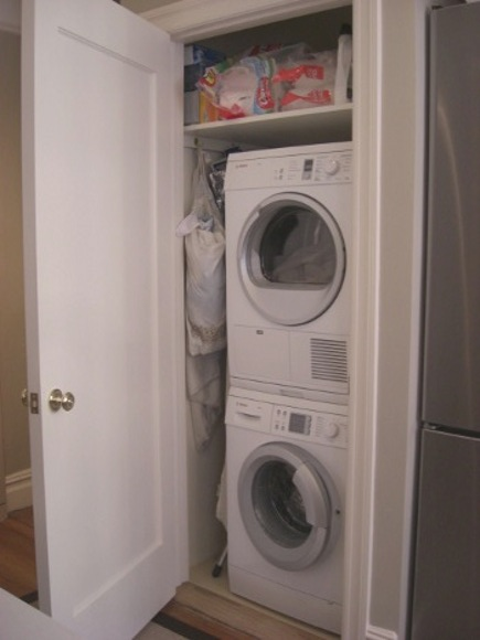 new laundry closet with Bosch Axxis front loader and condenser dryer