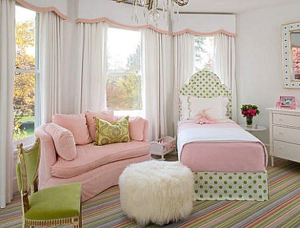 pink white and green kids bedroom with upholstered headboard twin girl's bed by Robyn Karp Interiors via Atticmag