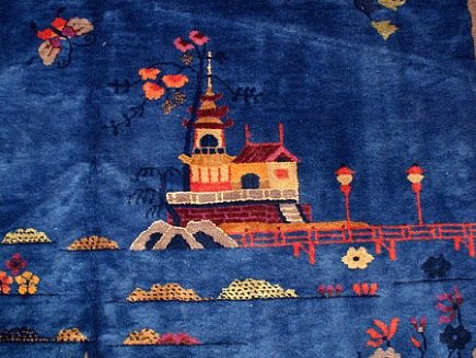 Chinese Art Deco Rugs - vivid sapphire blue rug with pagoda, bridge and floral motifs - via Atticmag