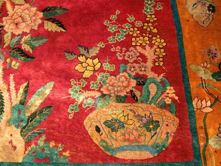 Chinese Art Deco Rugs - Nichols rug with an orange border, green frame, and red field with elaborate porcelain bowls of flowers - via Atticmag
