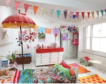 colorful childrens room decorated with Mexican papel picado banners