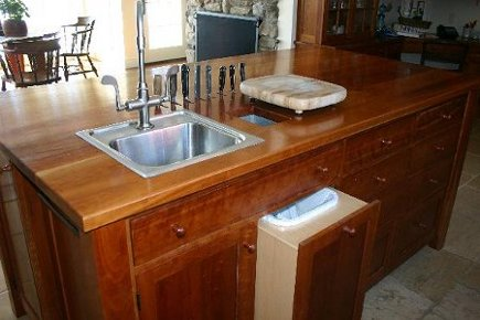 natural cherry kitchen island with prep sink and built ins