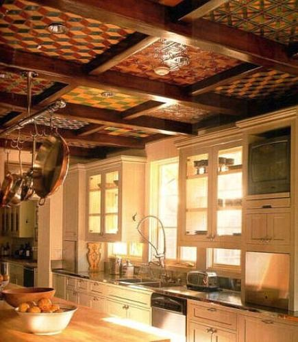 hand painted tiles in cofferred wood kitchen ceiling - via Atticmag
