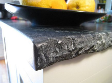 detail of chiseled edge on outside of the black and white kitchen island