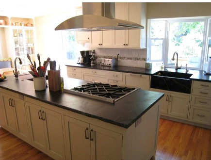 view of the black and white kitchen with two sinks