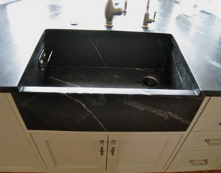 M. Teixiera Barocca custom soapstone sink in front of bay window