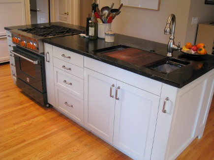 island with Kohler stages sink in renovated black and white kitchen